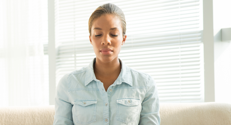 Young woman trying meditation practice