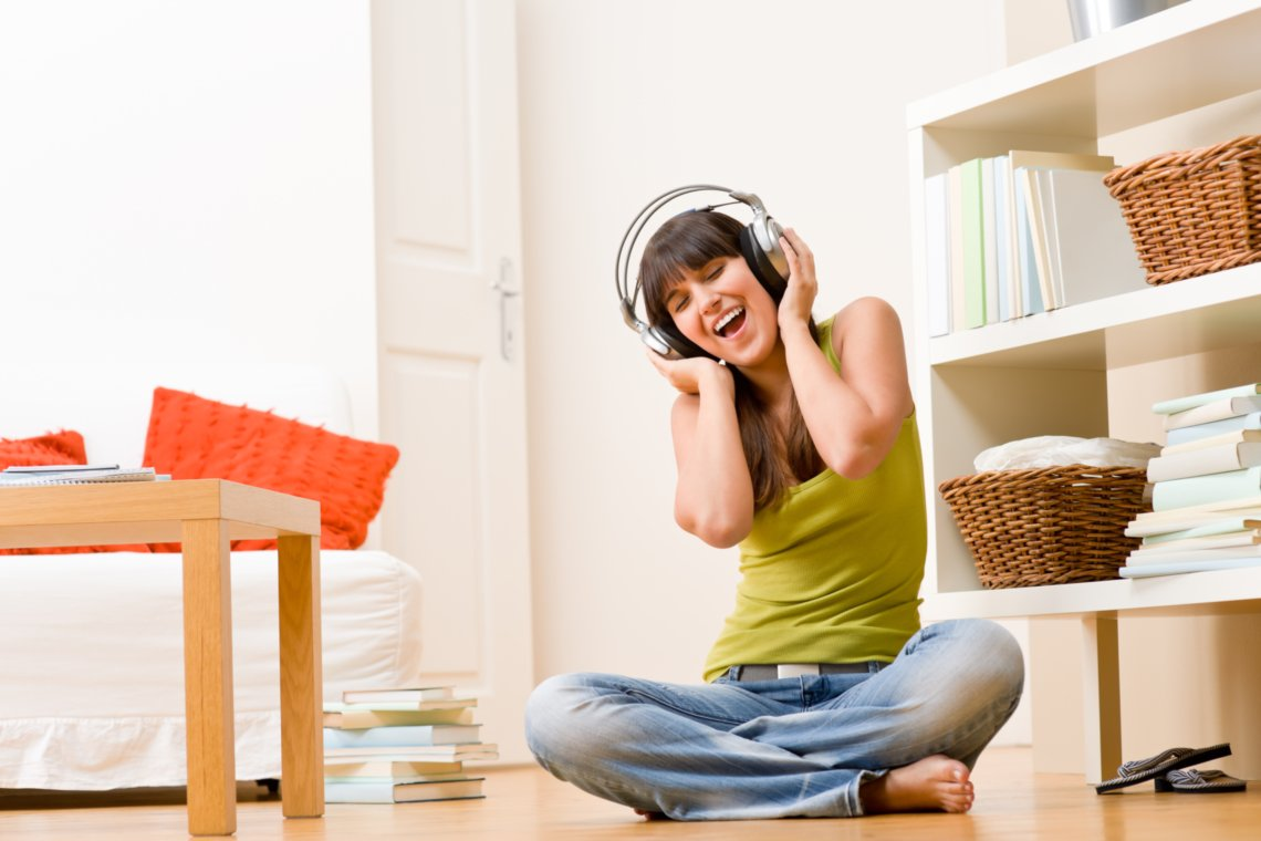 Music is Therapeutic - Woman happily listening to music on headphones